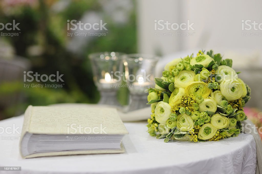 Beautiful flowers and photo album on a table stock photo