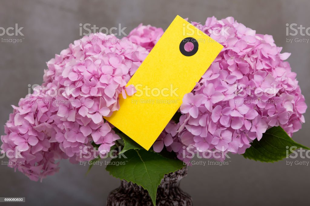Beautiful flowers bouquet with notecard stock photo