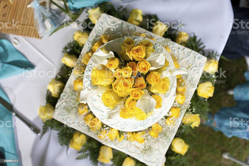 Beautiful flowers on top of a wedding cake stock photo