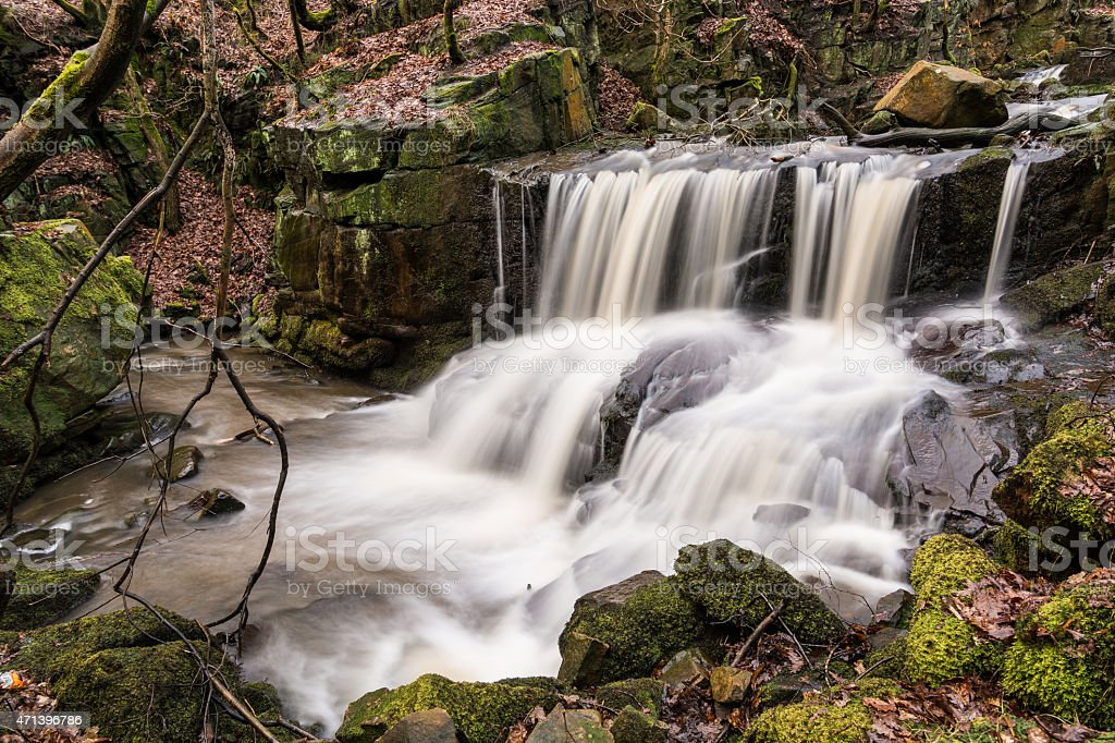 Beautiful Flowing Waterfall Jepson's Clough In The Rivington Woodland. stock photo