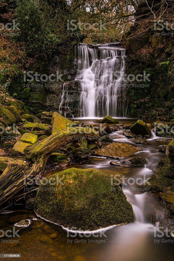 Beautiful Flowing Waterfall Tiger's Clough In The Rivington Woodland. stock photo