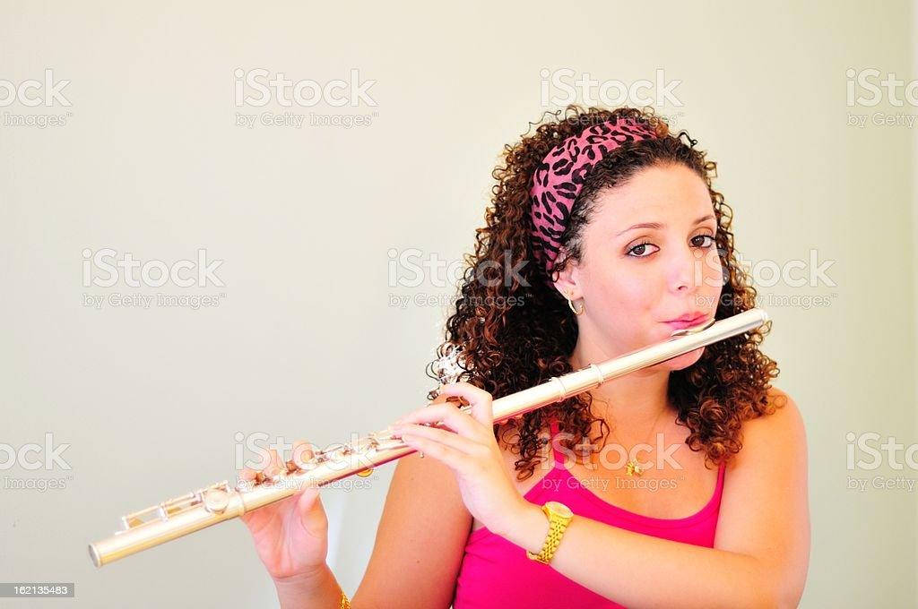 Beautiful flutist royalty-free stock photo