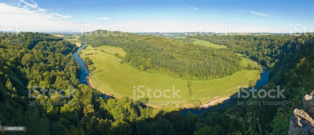 Beautiful forest valley River Wye vibrant green woodland pasture UK royalty-free stock photo