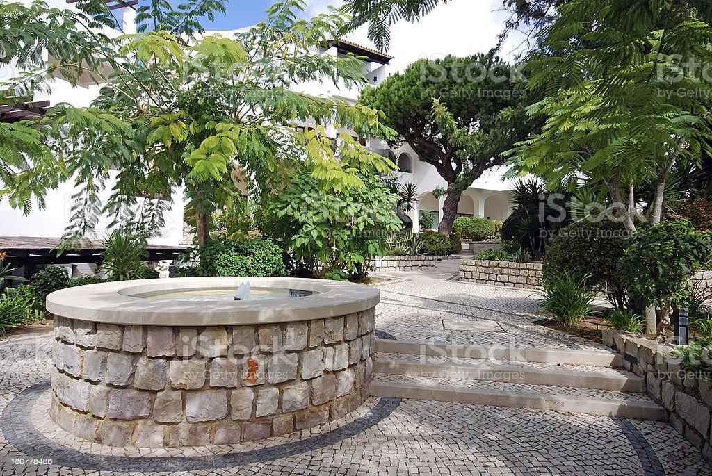 Beautiful fountain in scenic cobblestone patio, Algarve, Portugal royalty-free stock photo