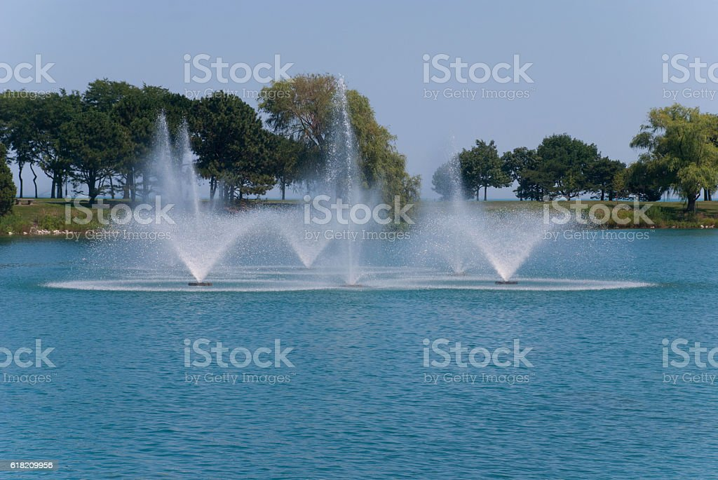 Beautiful fountain in the middle of the lake, Evanston, Illinois stock photo