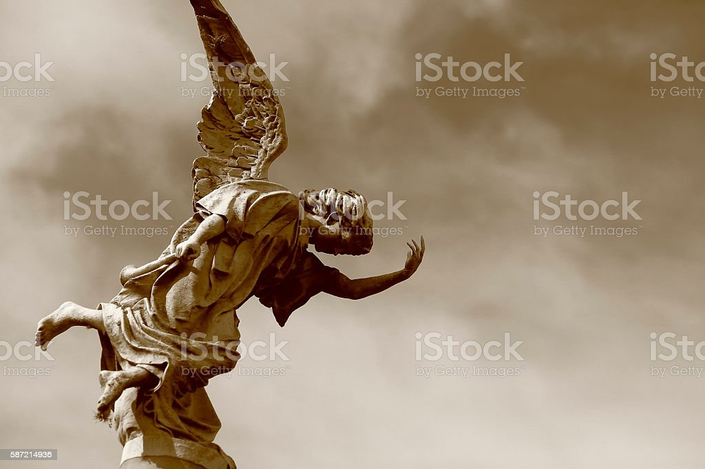 Beautiful fragile Madonna Angel, dramatic sky, Recoleta cemetery, Buenos Aires stock photo