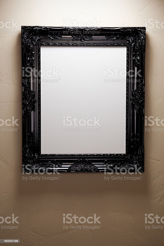 Beautiful Frame hanging on wall with white canvas royalty-free stock photo