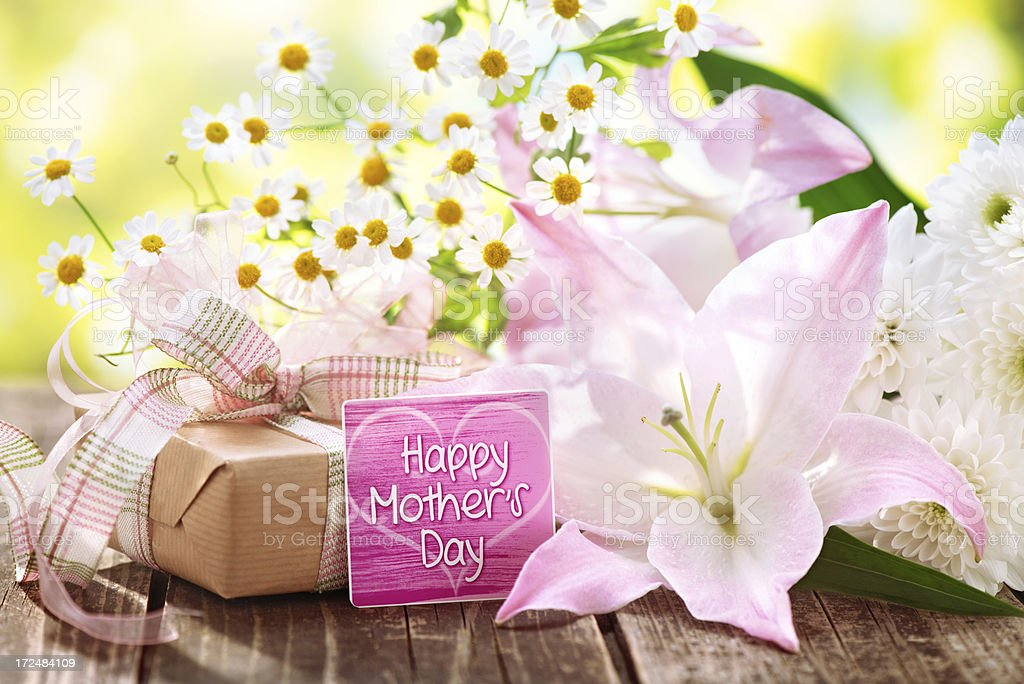 Beautiful fresh flower bouquet, gift box and morhers day card royalty-free stock photo