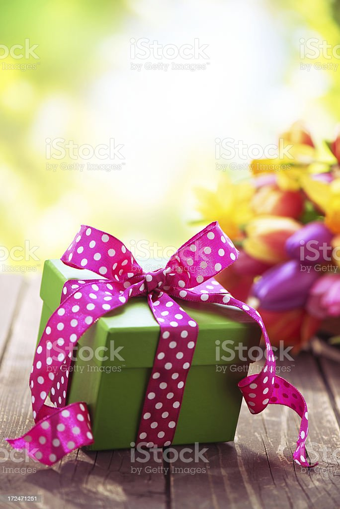 Beautiful fresh flower bouquet with a gift box royalty-free stock photo