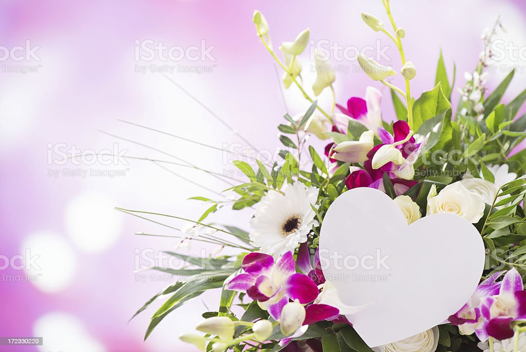 Beautiful fresh flower bouquet with an empty heart shaped card royalty-free stock photo