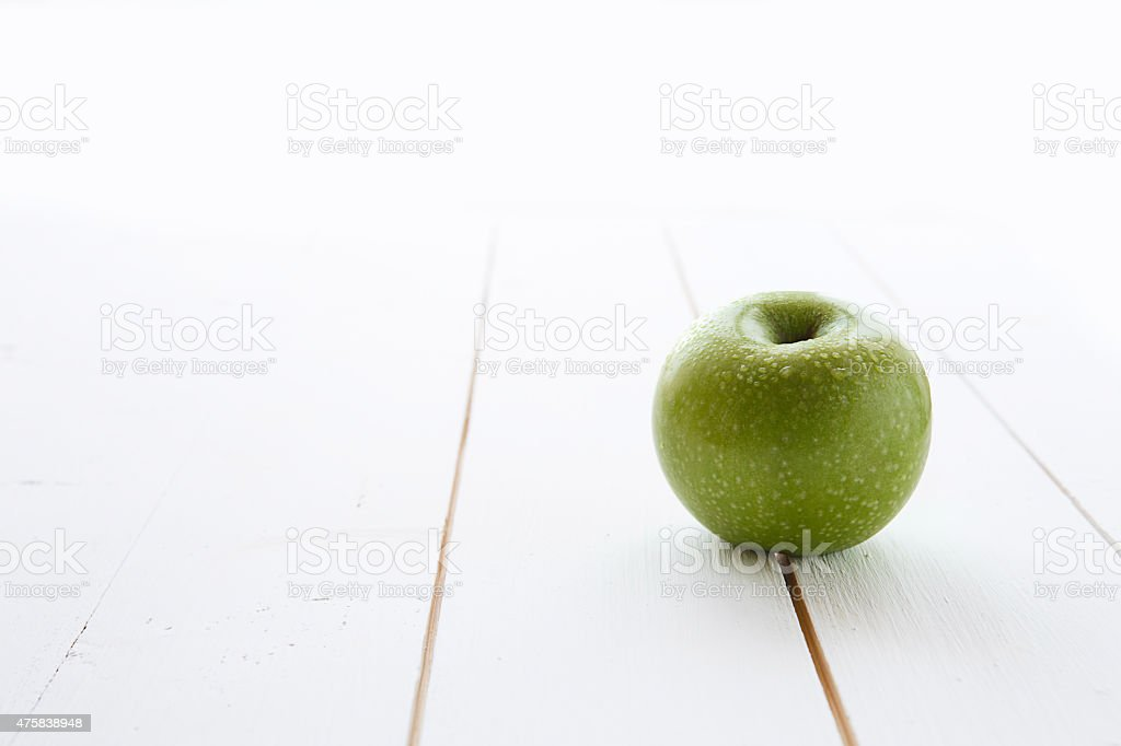Beautiful fresh green apple isolated stock photo