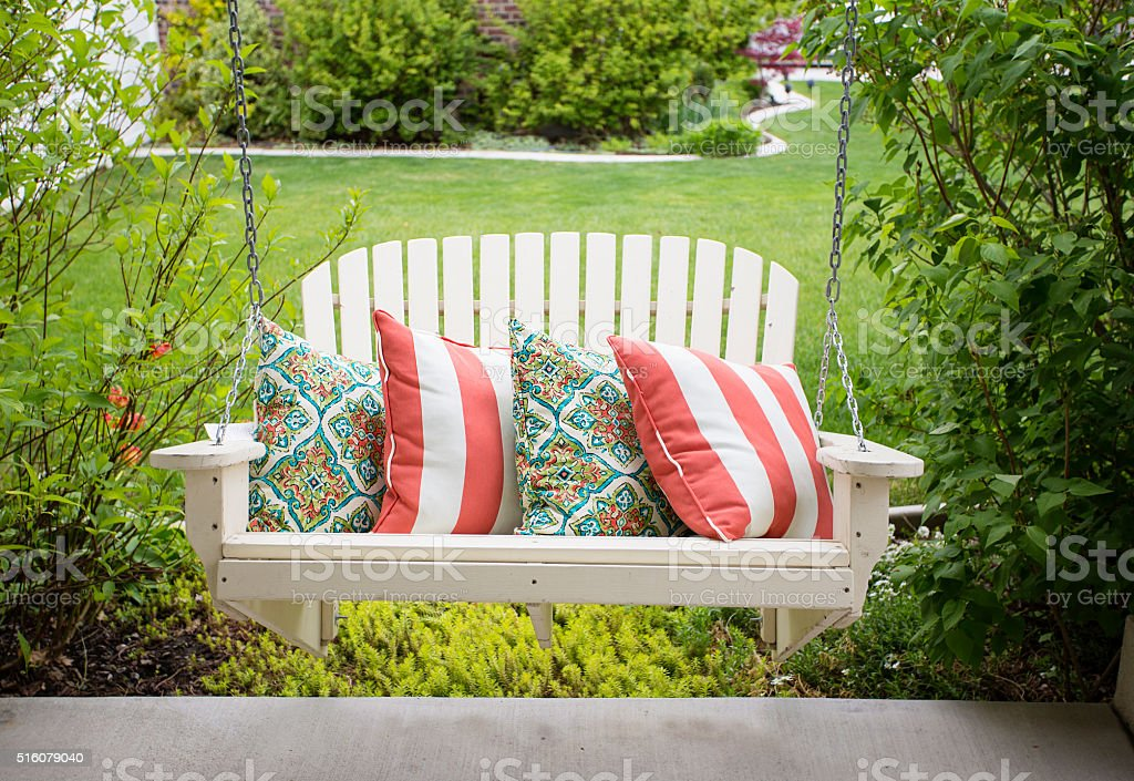 Beautiful front porch swing stock photo