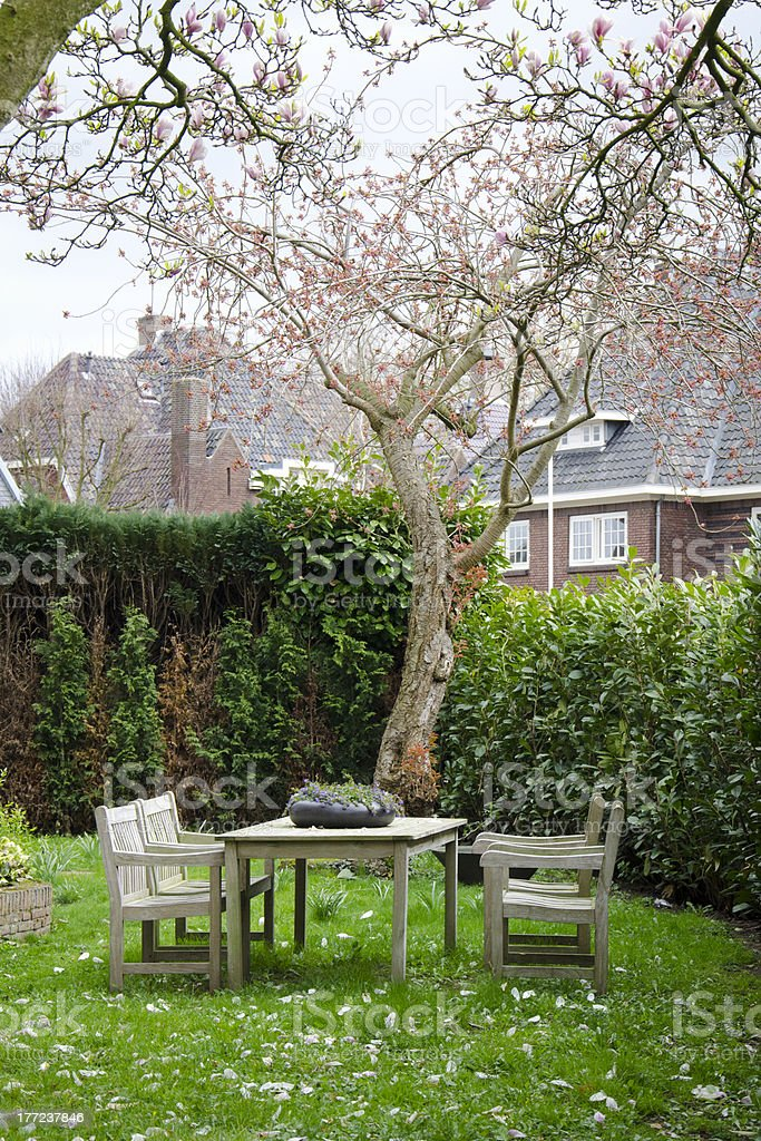 Beautiful garden with picnic table. royalty-free stock photo