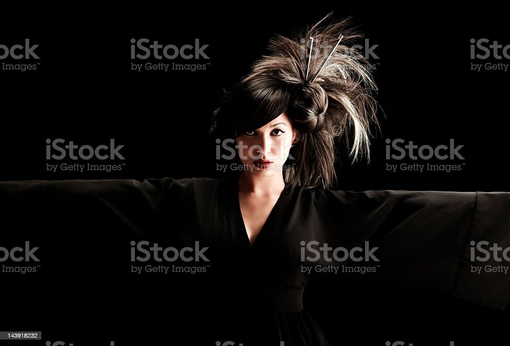 Beautiful geisha in kimono with dramatic hairstyle royalty-free stock photo