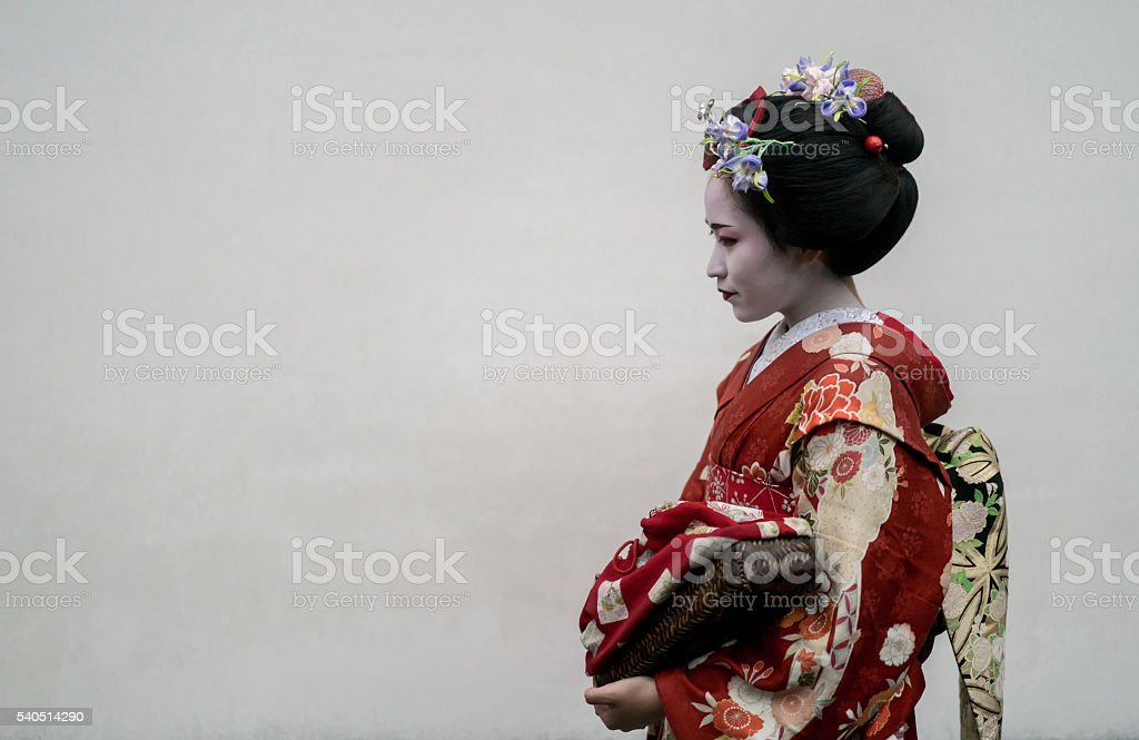 Beautiful Geisha wearing a kimono stock photo