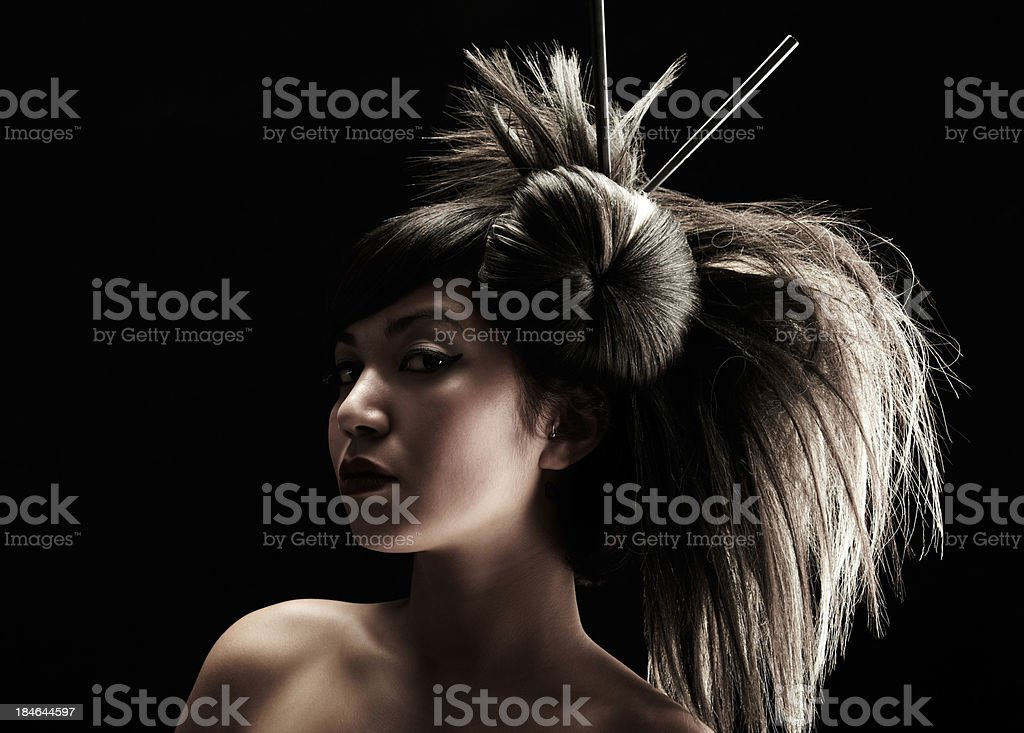 Beautiful geisha with dramatic hairstyle on black background royalty-free stock photo