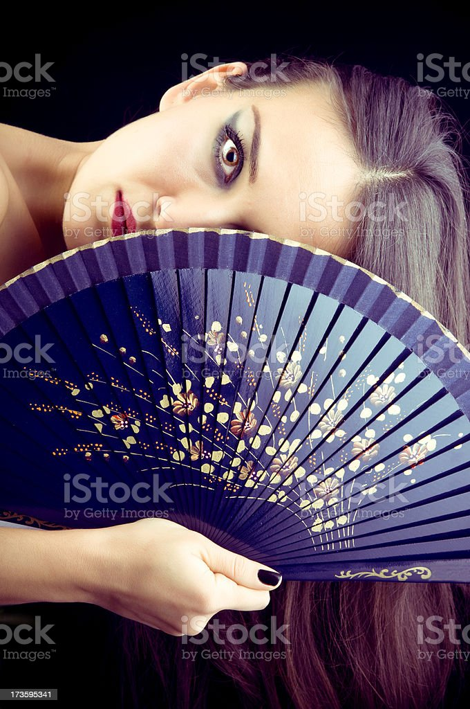 beautiful geisha with fan royalty-free stock photo