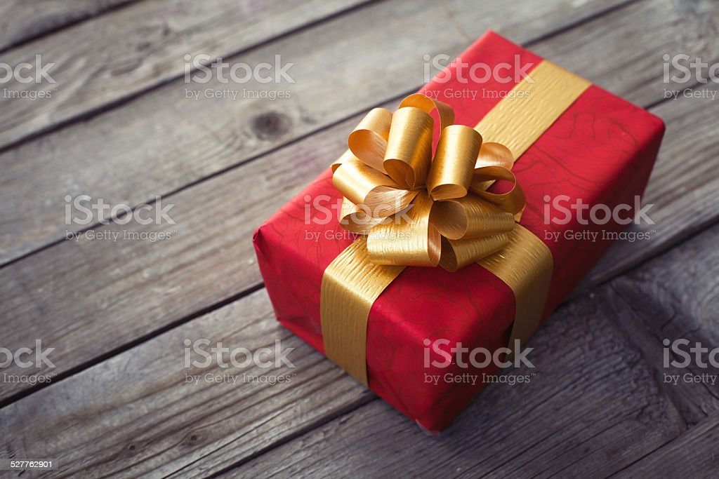 beautiful gift box on wooden desk stock photo