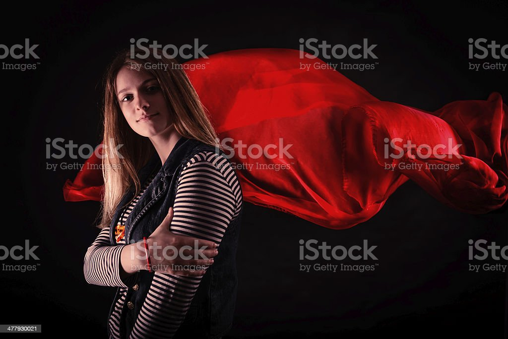 beautiful girl against red fabric in the dark royalty-free stock photo