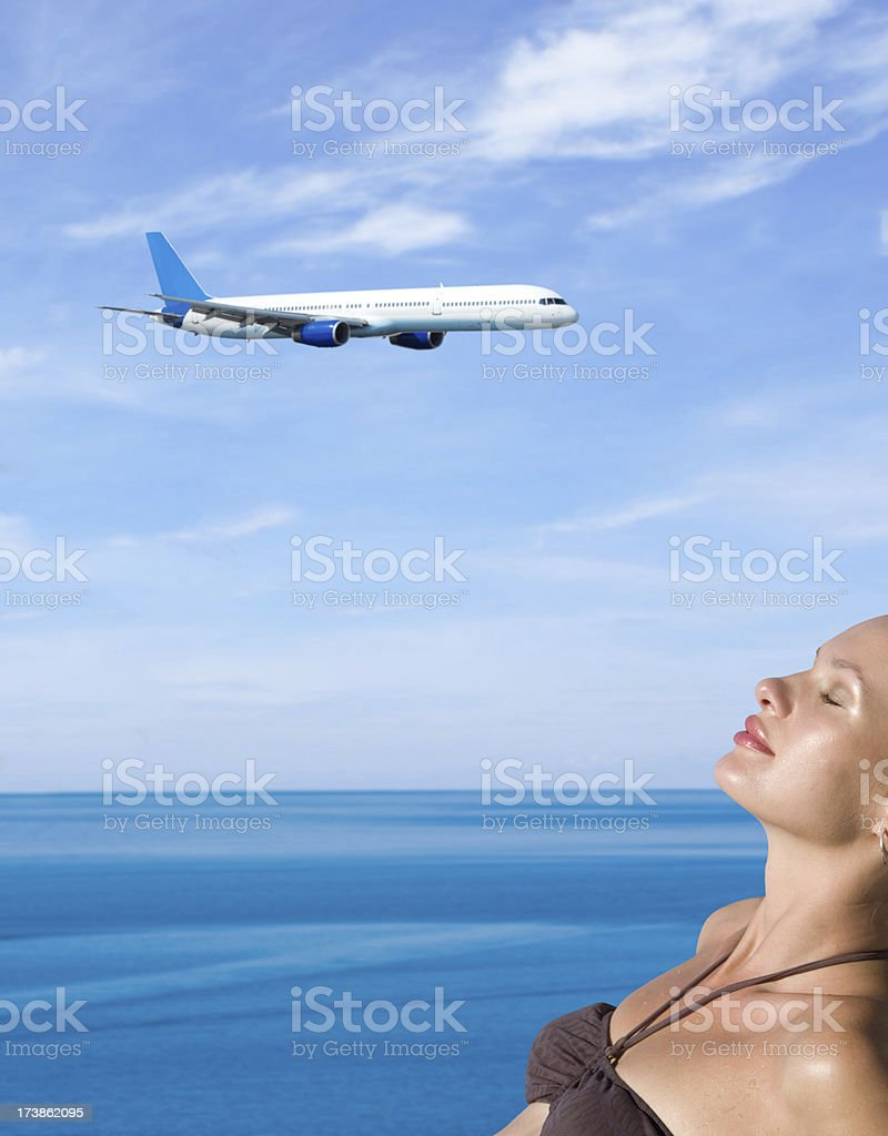 Beautiful girl and flying airplane stock photo