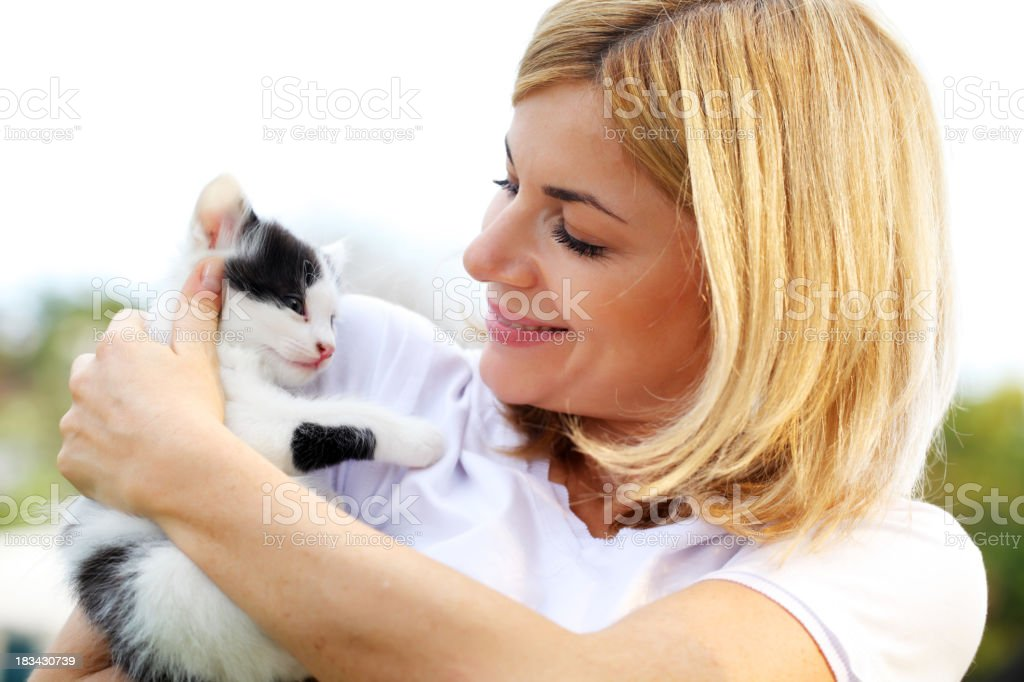 Beautiful girl and little cat outdoor. stock photo