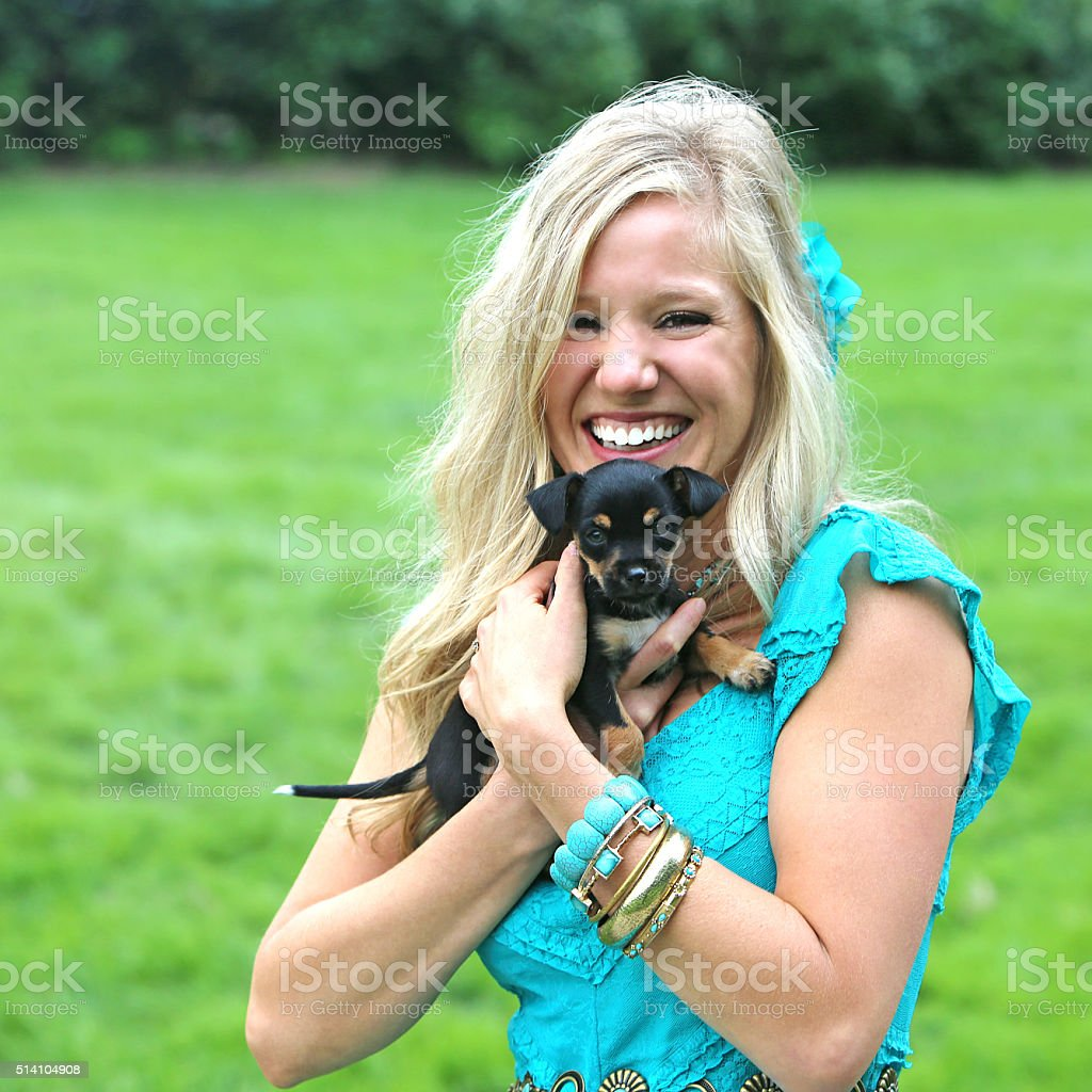 Beautiful Girl and Puppy stock photo
