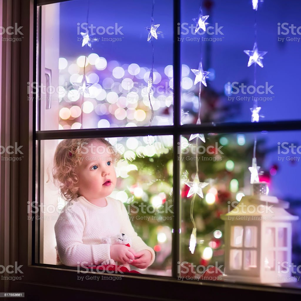 Beautiful girl at Christmas eve stock photo