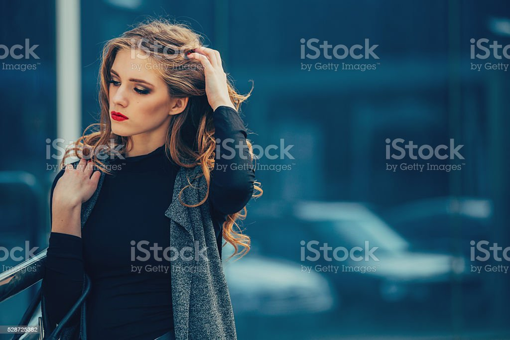 Beautiful girl at the business center in the open air. stock photo
