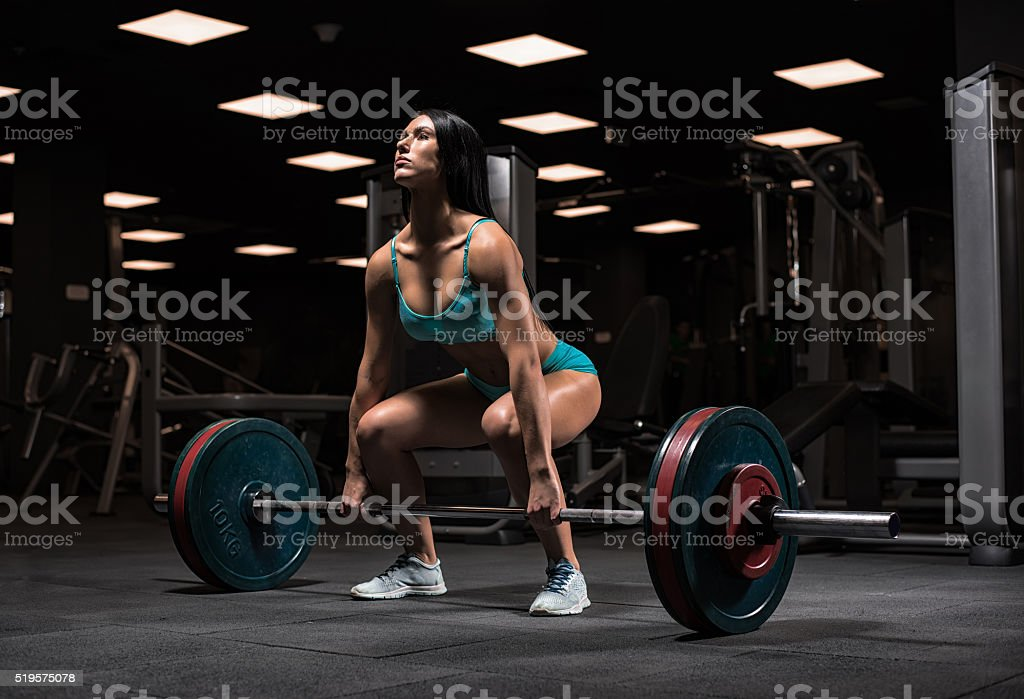 Beautiful girl at the gym stock photo