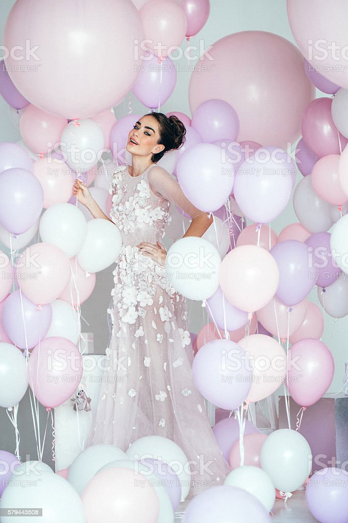 Beautiful girl at the studio with balloons stock photo