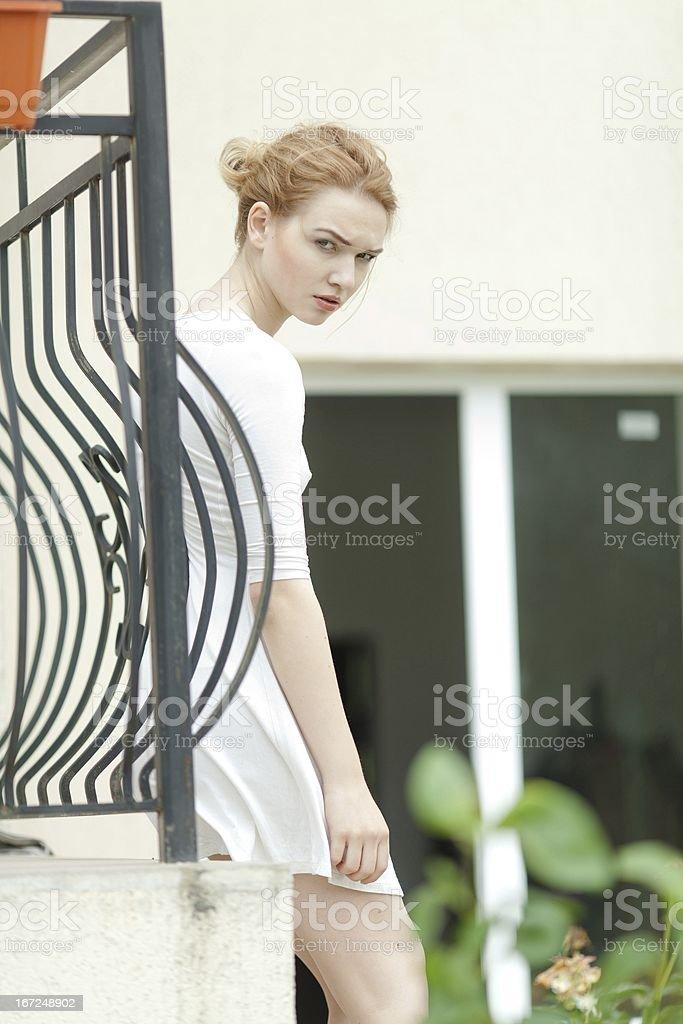 Beautiful girl at the yard royalty-free stock photo
