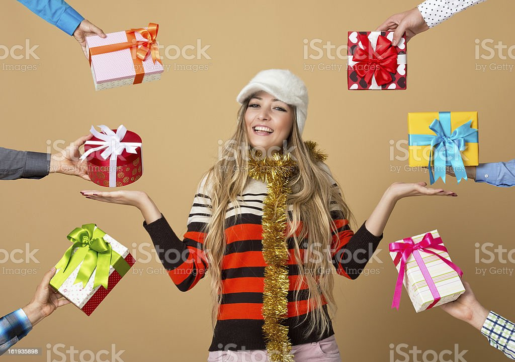 Beautiful girl being offered gifts stock photo
