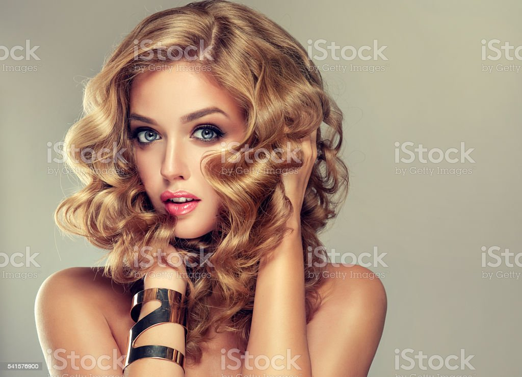 Beautiful girl blonde with an elegant hairstyle. stock photo