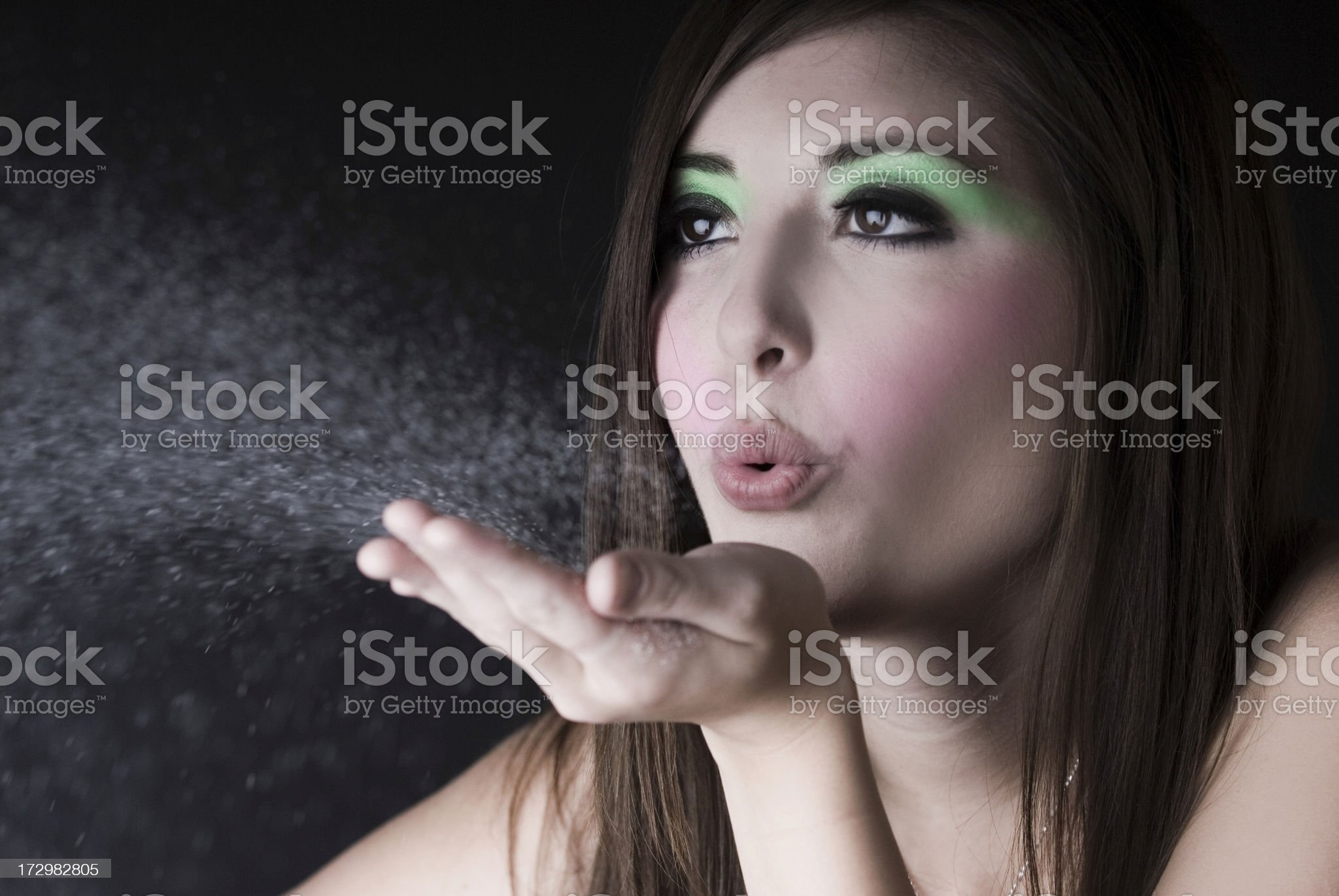 Beautiful Girl Blows White Dust royalty-free stock photo
