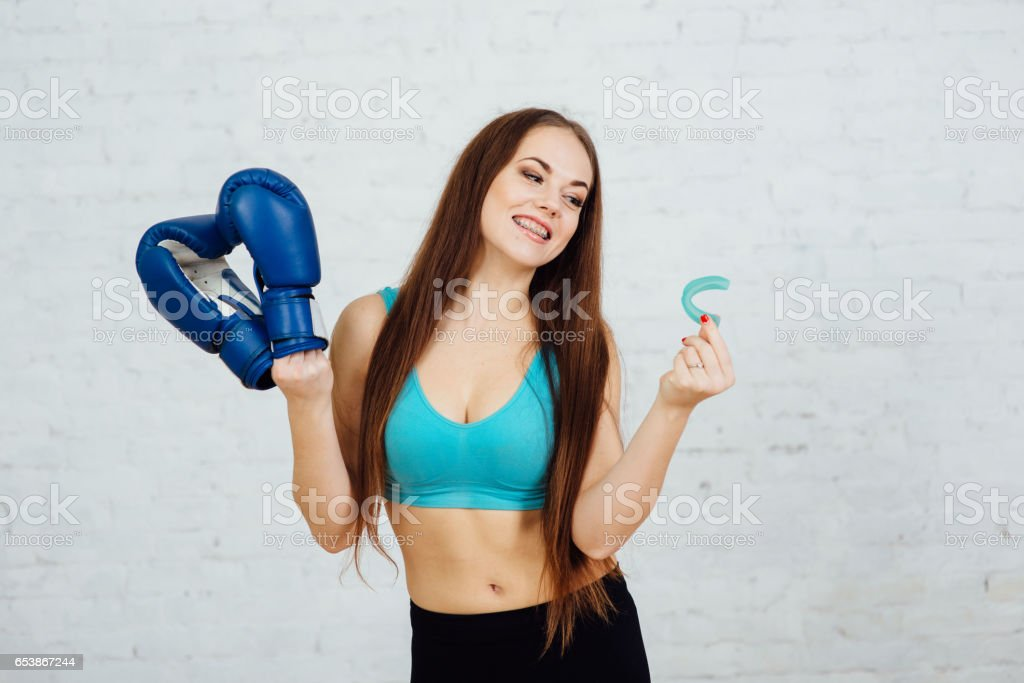 Beautiful girl boxer with braces stock photo