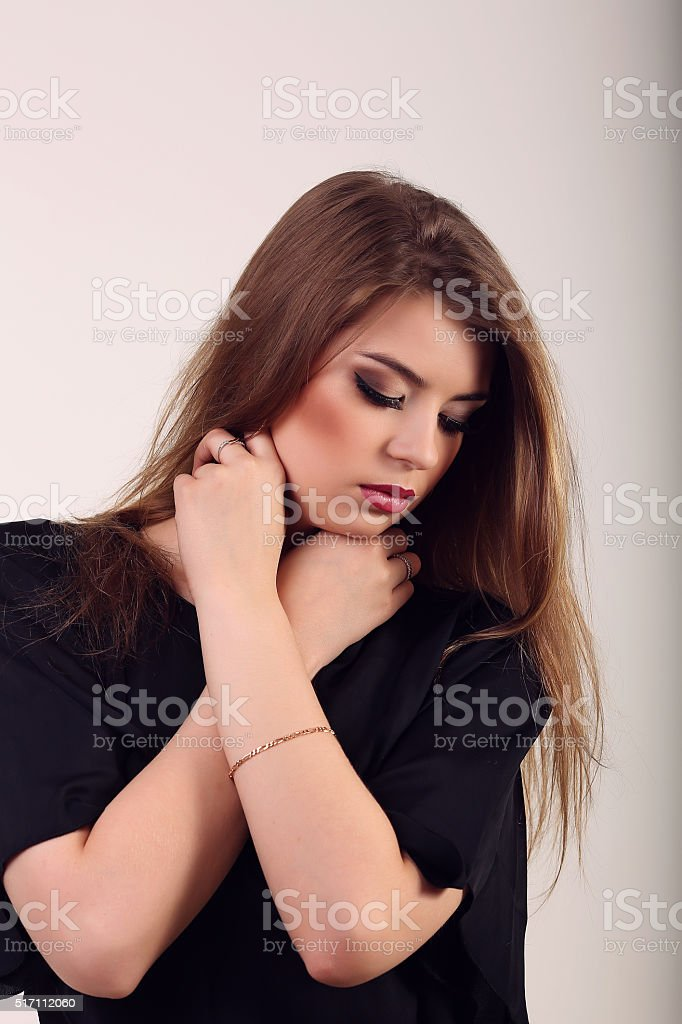 Beautiful girl brunetka with long hair, dress on one shoulder royalty-free stock photo