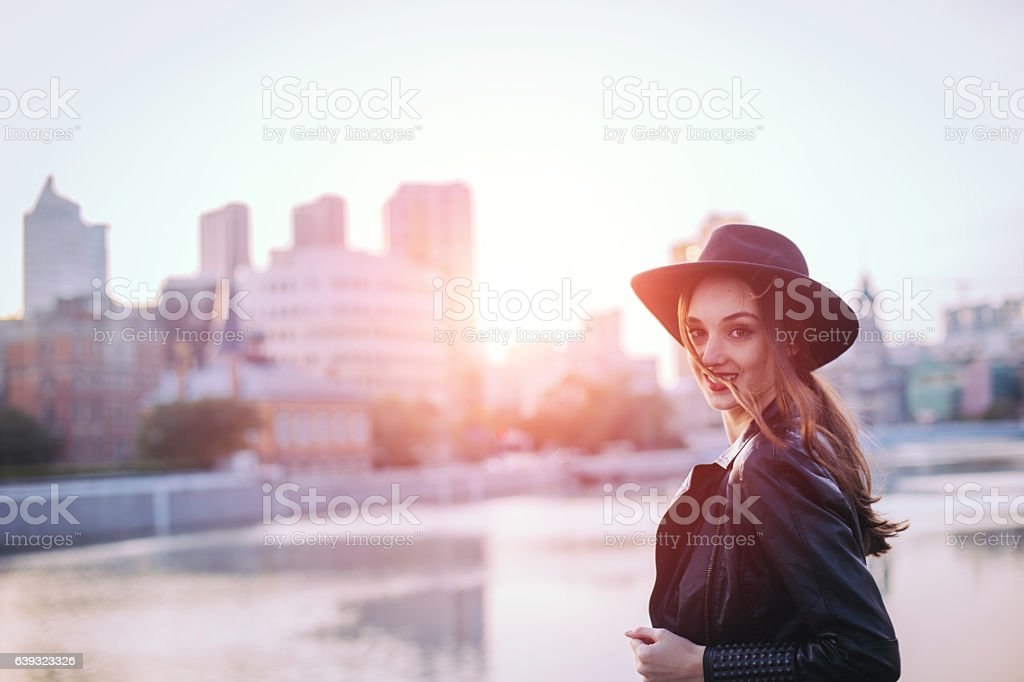 Beautiful girl by the river stock photo