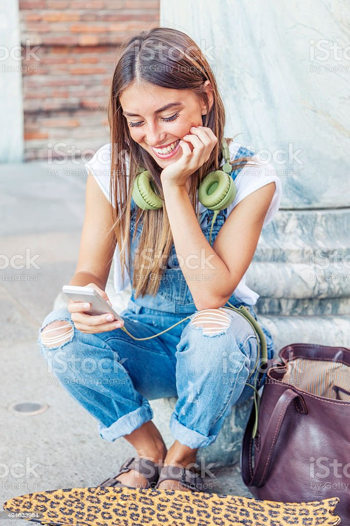 beautiful girl called her boyfriend with his smart phone stock photo