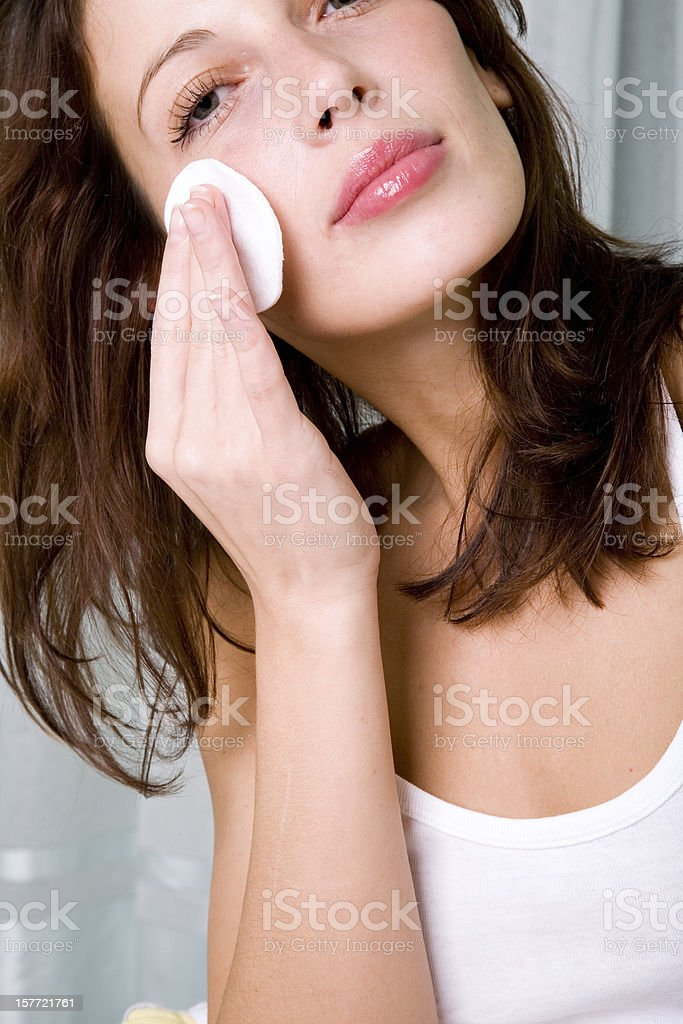 Beautiful Girl Cleaning Her Face royalty-free stock photo