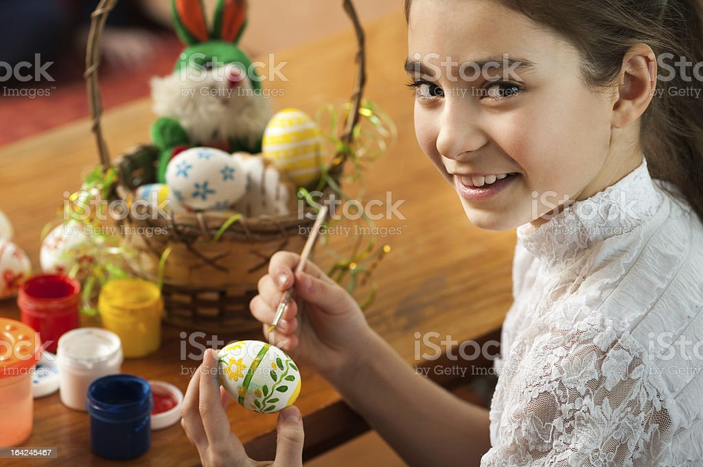 beautiful girl colored Easter eggs royalty-free stock photo