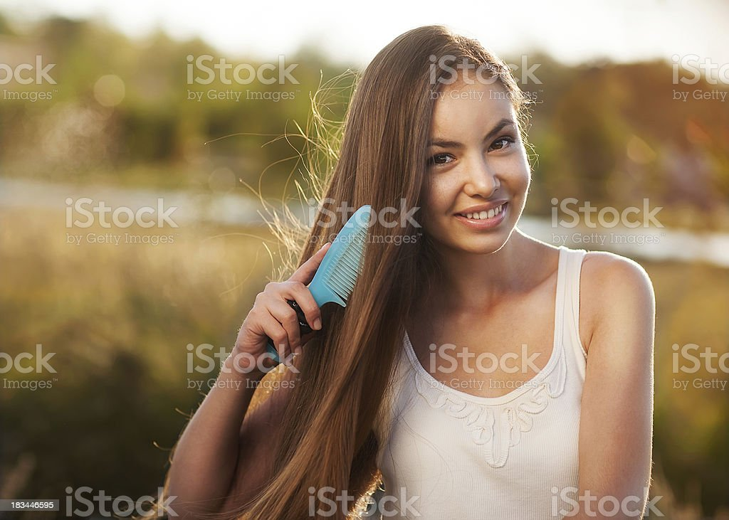 beautiful girl combs her hair Asian appearance royalty-free stock photo