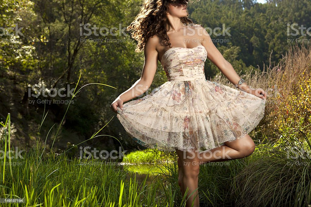 Beautiful girl dancing in the nature royalty-free stock photo