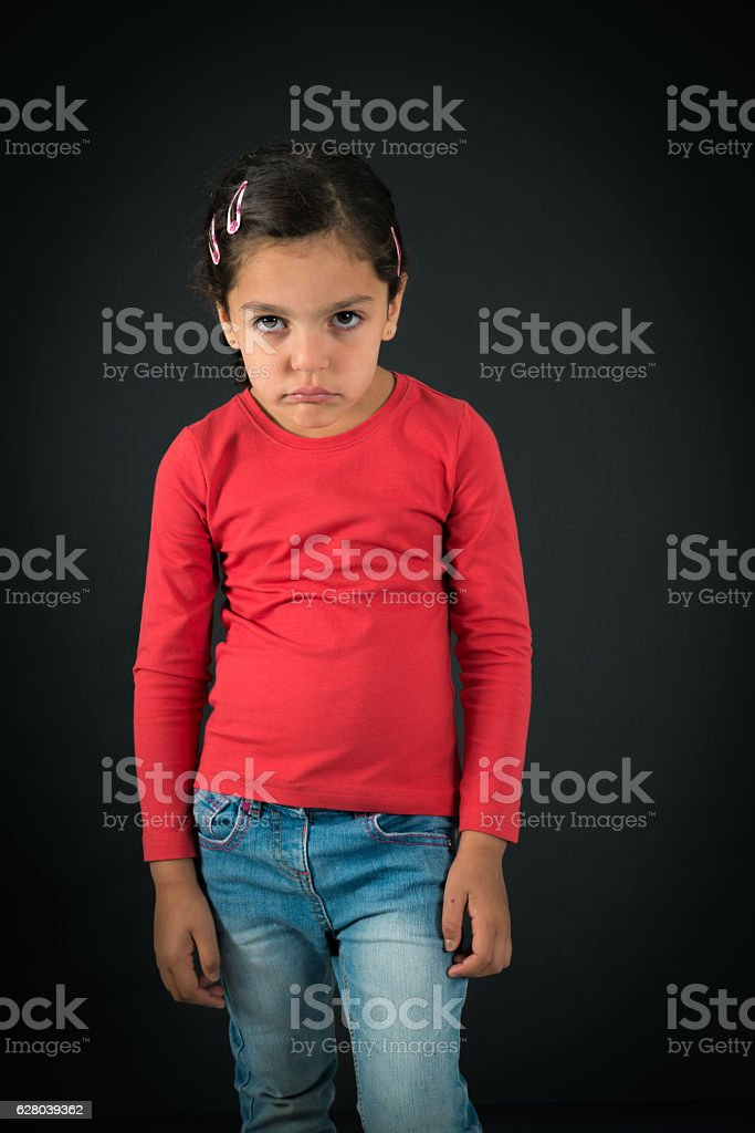 Beautiful girl doing different expressions in different sets of clothes: sad stock photo