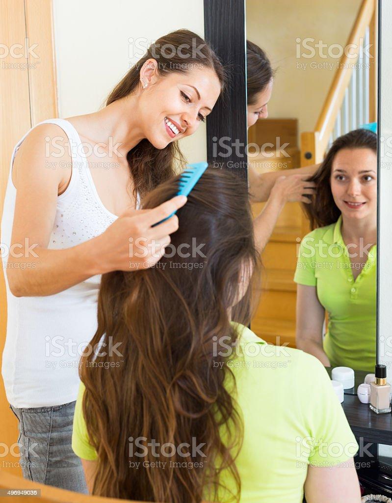 Beautiful girl doing hairstyle stock photo