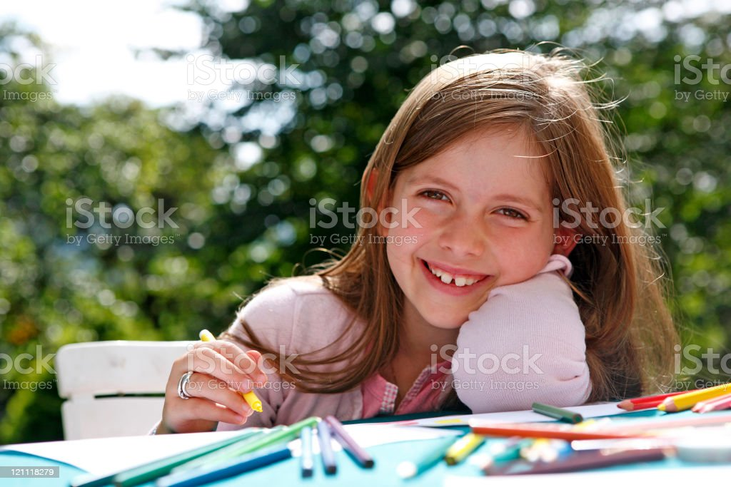 Beautiful girl doing homework outside royalty-free stock photo
