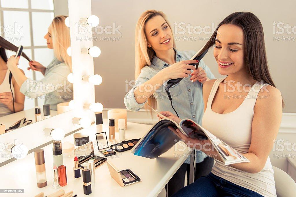 Beautiful girl doing makeup stock photo