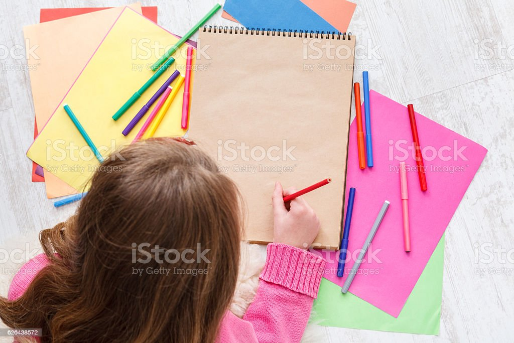 Beautiful girl draw, writing letter to santa, wait for christmas stock photo
