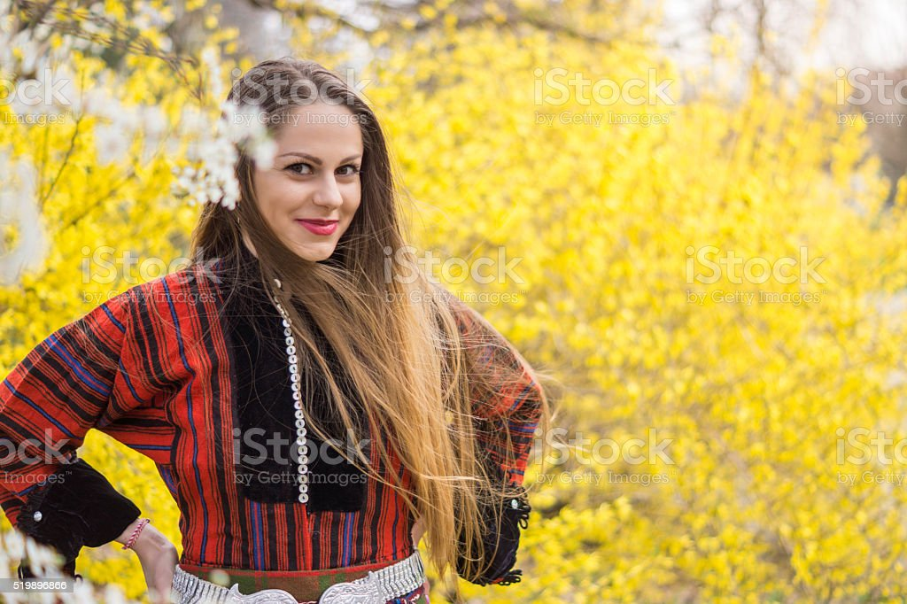 Beautiful girl dressed in traditional costume smiling stock photo