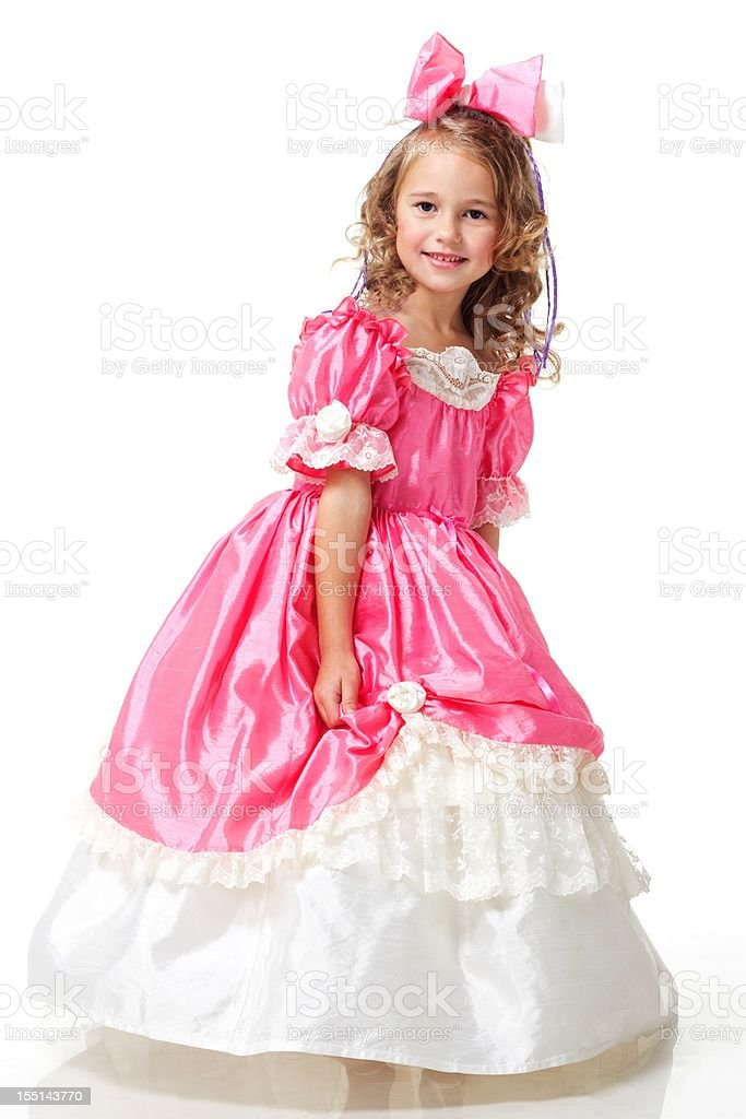 A beautiful girl dressed like a little princess stock photo