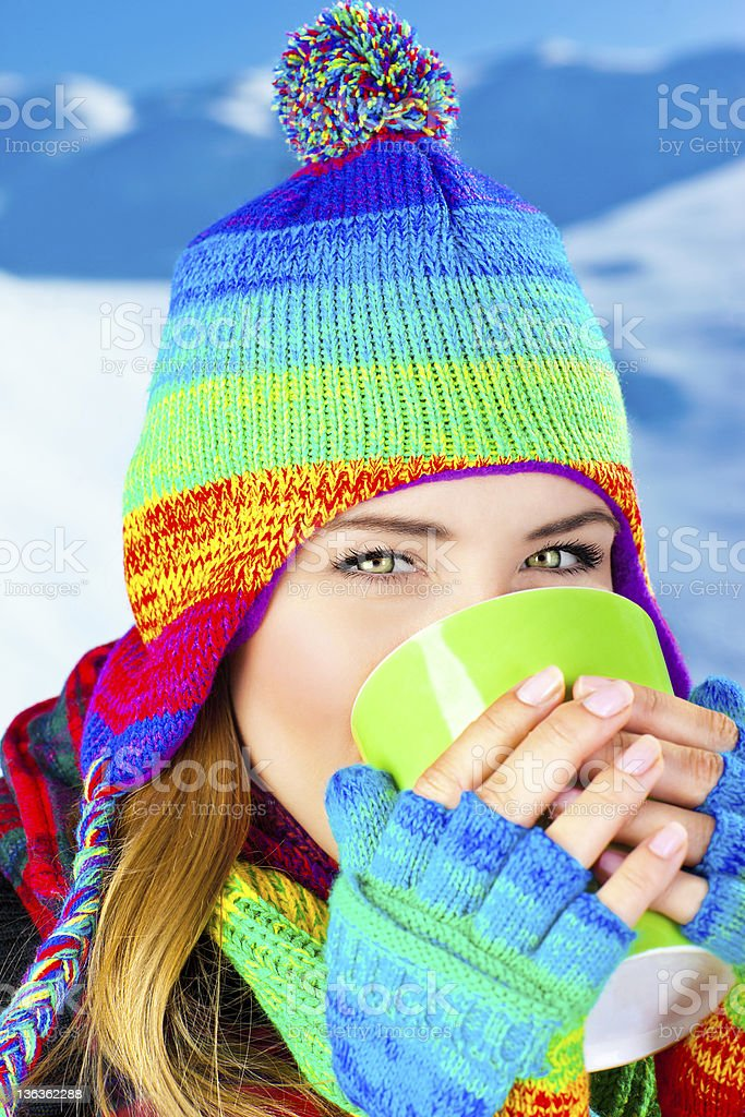 Beautiful girl drinking hot chocolate outdoor in winter royalty-free stock photo